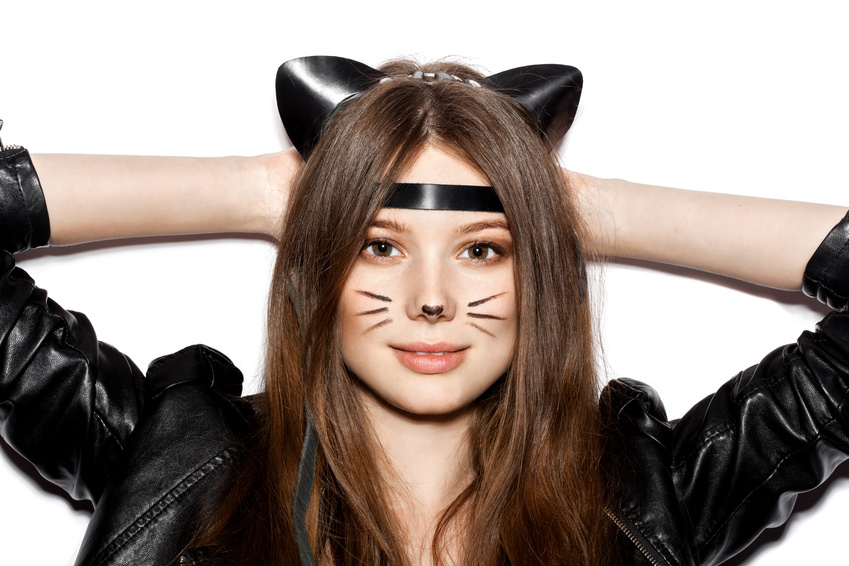woman with leather cat ears licking her shoulder